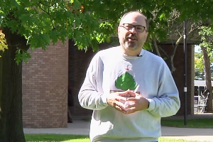 Screen grab from Co-op candidacy video, Dom speaking outdoors.